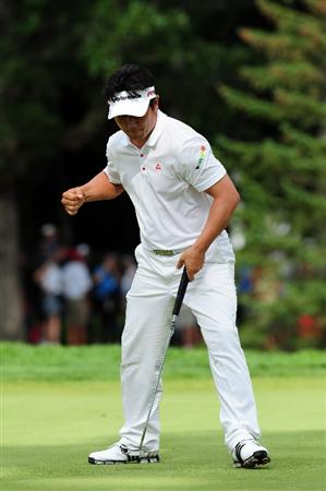 CHASKA, MN - AUGUST 16:  Y.E. Yang of South Korea celebrates on the 13th hole during the final round of the 91st PGA Championship at Hazeltine National Golf Club on August 16, 2009 in Chaska, Minnesota.  (Photo by Stuart Franklin/Getty Images)