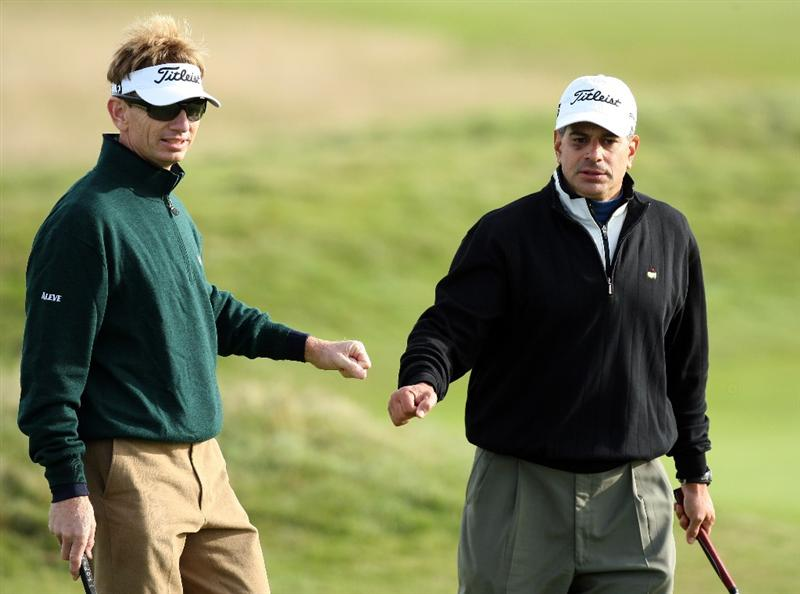 CARNOUSTIE, SCOTLAND - OCTOBER 01: Brad Faxon of the USA gestures with his playing partner Paul Salem on the 14th green during the first round of The Alfred Dunhill Links Championship at Carnoustie Golf Club on October 1, 2009 in Carnoustie, Scotland. (Photo by David Cannon/Getty Images