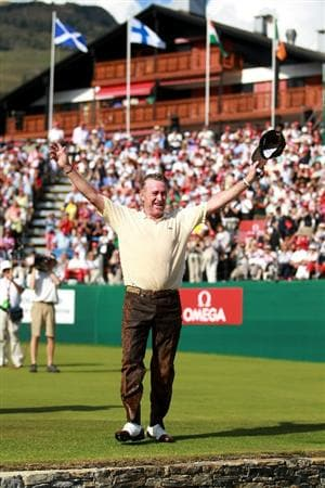 CRANS, SWITZERLAND - SEPTEMBER 05:  Miguel Angel Jimenez of Spain acknowledges the crowd after being pushed into the water by the 18th green by fellow Spanish players Pablo Larrazabal and Pablo Martin after winning The Omega European Masters on a score of -21 under par at Crans-Sur-Sierre Golf Club on September 5, 2010 in Crans Montana, Switzerland.  (Photo by Warren Little/Getty Images)