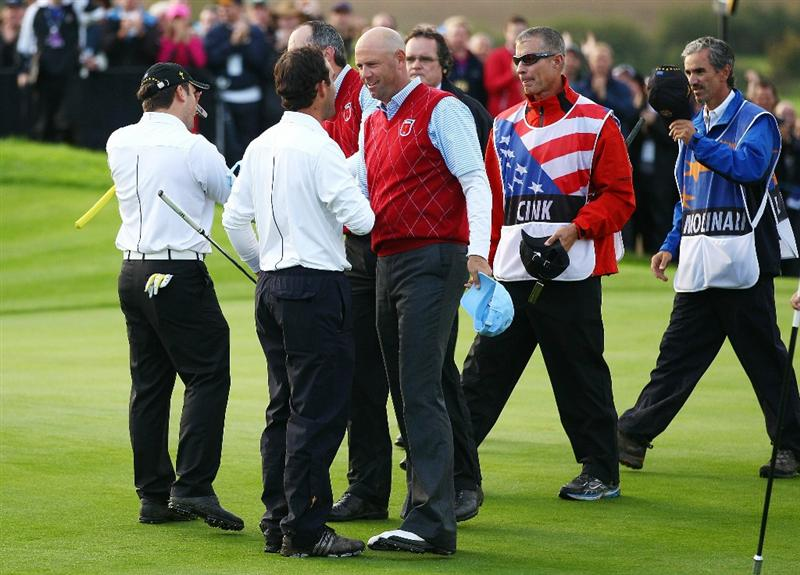 NEWPORT, WALES - OCTOBER 03:  Francesco Molinari of Europe and Edoardo Molinari are congratulated by Stewart Cink (R) and Matt Kuchar of the USA on the 18th green during the  Fourball & Foursome Matches during the 2010 Ryder Cup at the Celtic Manor Resort on October 3, 2010 in Newport, Wales.  (Photo by Richard Heathcote/Getty Images)