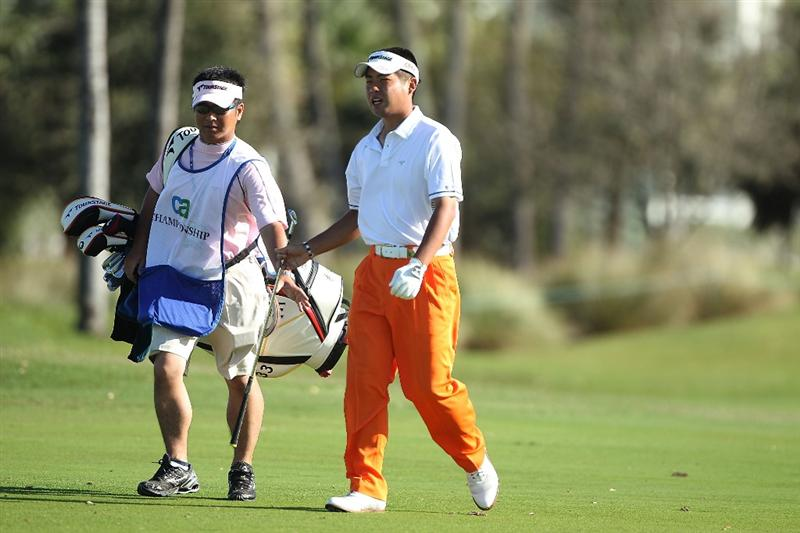 DORAL, FL - MARCH 13:  Yuta Ikeda of Japan walk up the 12th hole during round three of the 2010 WGC-CA Championship at the TPC Blue Monster at Doral on March 13, 2010 in Doral, Florida.  (Photo by Scott Halleran/Getty Images)