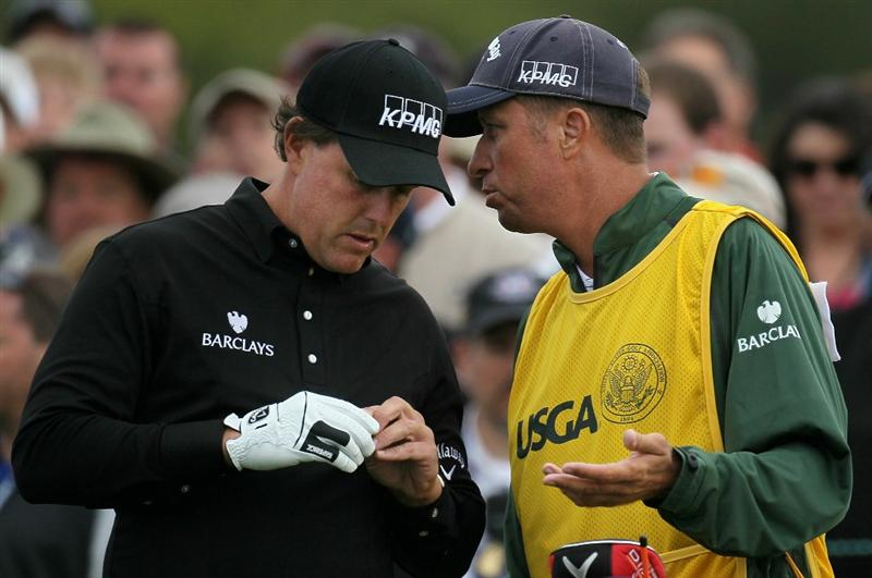PEBBLE BEACH, CA - JUNE 17:  Phil Mickelson waits with his caddie Jim Mackay on the tenth tee during the first round of the 110th U.S. Open at Pebble Beach Golf Links on June 17, 2010 in Pebble Beach, California.  (Photo by Stephen Dunn/Getty Images)