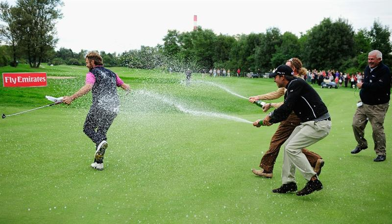 VIENNA, AUSTRIA - SEPTEMBER 19:  Jose Manuel Lara of Spain celebrates winning as he is sprayed with champagne by countrymen Miguel Angel Jimenez and  Pablo Larrazabal during the final round of the Austrian golf open presented by Botarin at the Diamond country club on September 19, 2010 in Atzenbrugg near Vienna, Austria.  (Photo by Stuart Franklin/Getty Images)