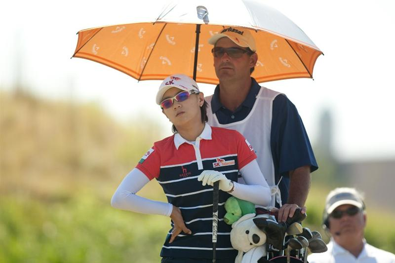 PRATTVILLE, AL - OCTOBER 9: Na Yeon Choi of South Korea shades herself with an umbrella during the third round of the Navistar LPGA Classic at the Senator Course at the Robert Trent Jones Golf Trail on October 9, 2010 in Prattville, Alabama. (Photo by Darren Carroll/Getty Images)