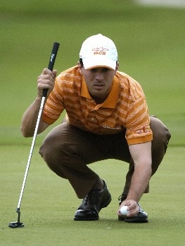 Mike Weir lines up a putt on the 17th green  during second-round competition March 4, 2005  at the Ford Championship at Doral in Miami.