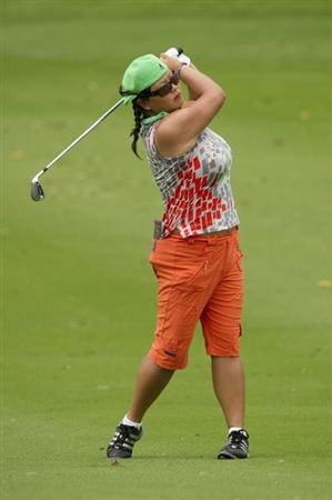 CHON BURI, THAILAND - FEBRUARY 20:  Christina Kim of USA plays an approach on the 9th hole during round three of the Honda PTT LPGA Thailand at Siam Country Club on February 20, 2010 in Chon Buri, Thailand.  (Photo by Victor Fraile/Getty Images)