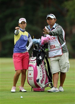 SUNNINGDALE, UNITED KINGDOM - AUGUST 03:  Momoko Ueda of Japan prepares to hit her second shot at the 9th hole during the final round of the 2008  Ricoh Women's British Open Championship held on the Old Course at Sunningdale Golf Club, on August 3, 2008 in Sunningdale, England.  (Photo by David Cannon/Getty Images)