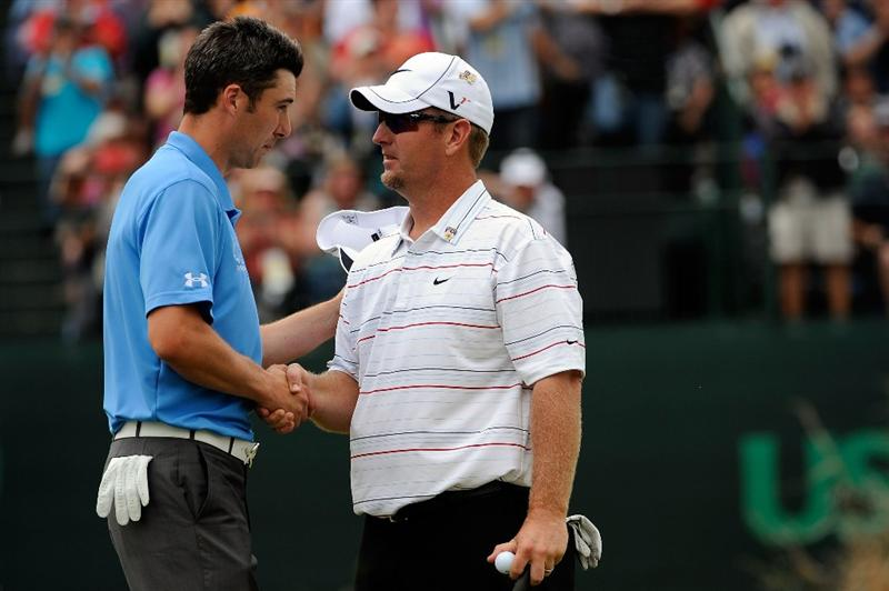 FARMINGDALE, NY - JUNE 22:  (L-R) Ross Fisher of England and David Duval shake hands on the 18th hole during the continuation of the final round of the 109th U.S. Open on the Black Course at Bethpage State Park on June 22, 2009 in Farmingdale, New York.  (Photo by Sam Greenwood/Getty Images)