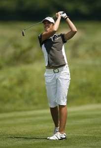 Jill McGill hits her tee shot on the 4th hole during first round of the 61st US Womens Open being held at the Newport Country Club in Newport, Rhode Island on June 30, 2006.