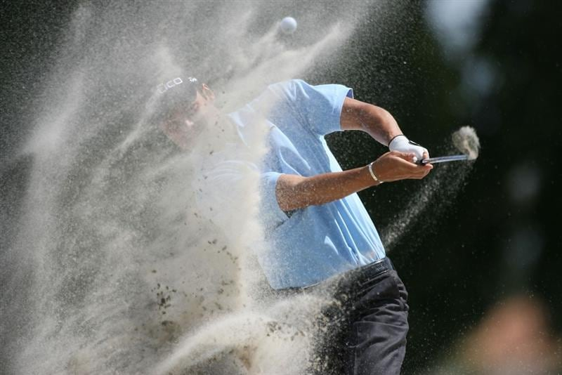 DORAL, FL - MARCH 14:  Martin Kaymer of Germany hits out of the bunker on the girst hole during the final round of the 2010 WGC-CA Championship at the TPC Blue Monster at Doral on March 14, 2010 in Doral, Florida.  (Photo by Marc Serota/Getty Images)