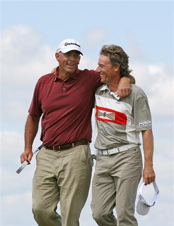 SAVANNAH, GA - APRIL 26:  Tom Lehman (L) celebrates with playing partner Bernhard Langer (R) of Germany after they made par on the second playoff hole to win the Liberty Mutual Legends of Golf at the Westin Savannah Harbor Golf Resort and Spa on April 26, 2009 in Savannah, Georgia. (Photo by Hunter Martin/Getty Images)