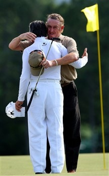 AUGUSTA, GA - APRIL 11:  Miguel Angel Jimenez of Spain hugs Gary Player of South Africa on the 18th green during the second round of the 2008 Masters Tournament at Augusta National Golf Club on April 11, 2008 in Augusta, Georgia.  (Photo by Andrew Redington/Getty Images)