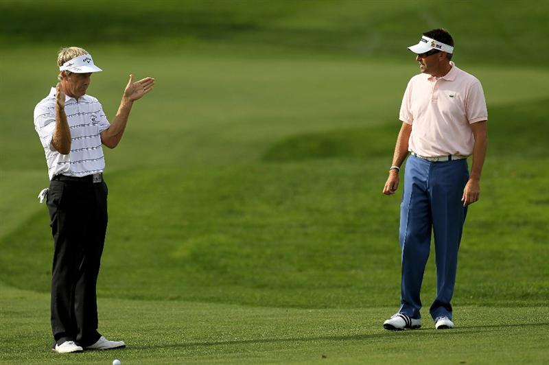 LA JOLLA, CA - JANUARY 29:  Fellow Australians Stuart Appleby (L) and Robert Allenby talk things over on the 13th fairway at the North Course at Torrey Pines Golf Course during the second round of the Farmers Insurance Open on January 29, 2010 in La Jolla, California. (Photo by Stephen Dunn/Getty Images)