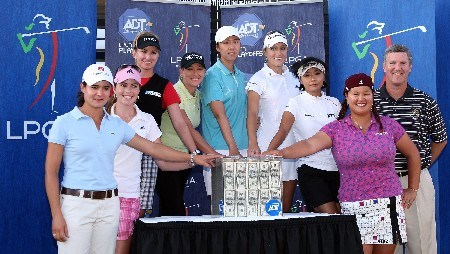 WEST PALM BEACH, FL - NOVEMBER 17:  The final eight players (L-R) Lorena Ochoa, Paula Creamer, Karrie Webb, Cristie Kerr, Sarah Lee, Natalie Gulbis, Mi Hyun Kim, and Christina Kim pose with John Koch (back right) of ADT and the Million Dollar Prize after the completion of the third round of the 2007 ADT Championship held at the Trump International Golf Course, on November 17, 2007 in West Palm Beach, Florida.  (Photo by David Cannon/Getty Images)