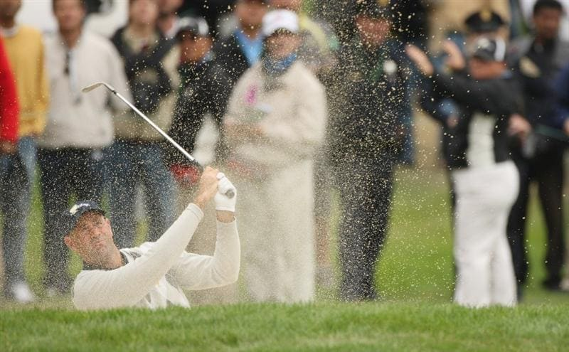 SAN FRANCISCO - OCTOBER 10:  Stewart Cink of the USA Team plays out of the 16th greenside bunker during the Day Three Morning Foursomes Matches of The Presidents Cup at Harding Park Golf Course on October 10, 2009 in San Francisco, California.  (Photo by Warren Little/Getty Images)
