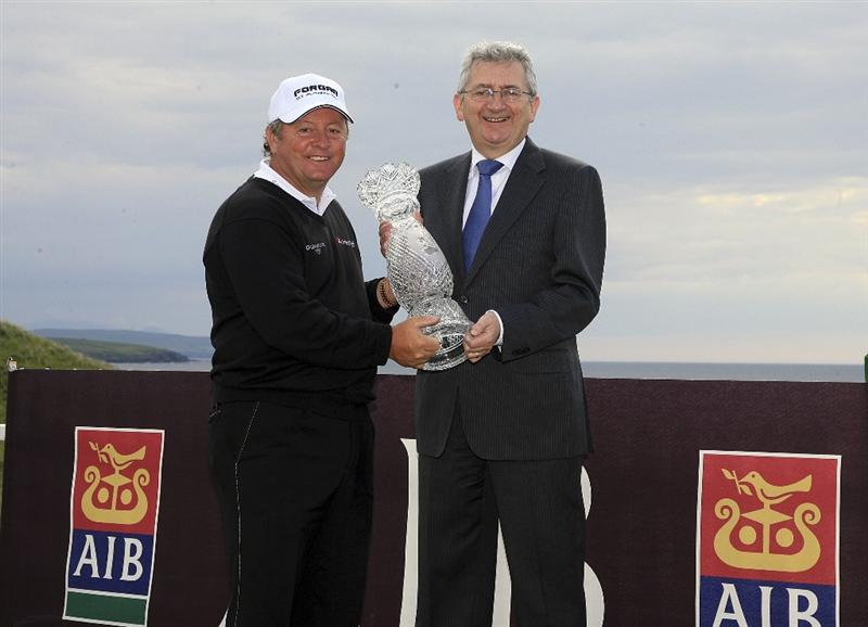 BALLYBUNION, IRELAND - JUNE 07:  Ian Woosnam of Wales is presented with the trophy by Billy Andrews of AIB Bank  after the three hole play off during the final round of the Irish Seniors Open played at the Old Course, Ballybunion Golf Club on June 7, 2009 in Ballybunion, Ireland  (Photo by Phil Inglis/Getty Images)