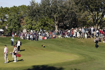 Spectators gather to watch Bill Murray (left) on the seventh green during the second round of the 2007 Outback Steakhouse Pro-Am Saturday, February 17, 2007, at the TPC of Tampa bay in Tampa, Florida. Champions Tour - 2007 Outback Steakhouse Pro-Am - Second RoundPhoto by Kevin C.  Cox/WireImage.com
