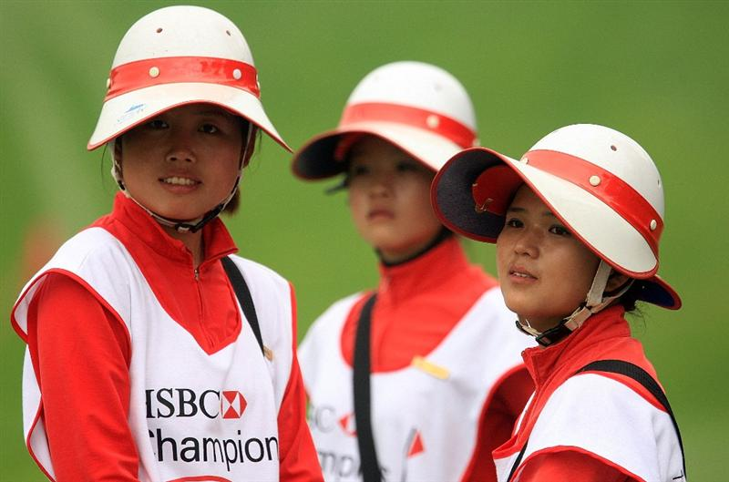 SHANGHAI, CHINA - NOVEMBER 05:  Club caddies watch the play during practice prior to the start of the HSBC Champions at Sheshan International Golf Club on November 5, 2008 in Shanghai, China.  (Photo by Scott Halleran/Getty Images)