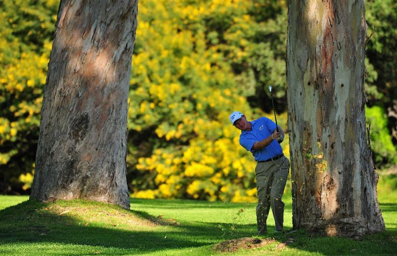 PACIFIC PALISADES, CA - FEBRUARY 19:  Ernie Els of South Africa plays his approach shot on the 13th hole during the first round of the Northern Trust Open at the Riviera Country Club February 19, 2009 in Pacific Palisades, California.  (Photo by Stuart Franklin/Getty Images)