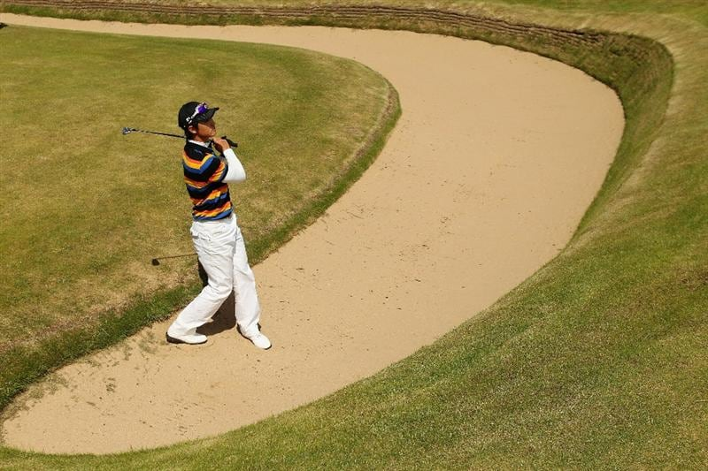 GULLANE, SCOTLAND - JUNE 19:  Jin Jeong of South Korea plays out of the seventh fairway bunker during the final against James Byrne of Scotland for The Amateur Championship at Muirfield Golf Club on June 19, 2010 in Gullane, Scotland.  (Photo by Warren Little/Getty Images)