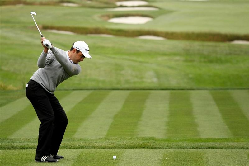 PEBBLE BEACH, CA - JUNE 15:  Simon Khan of England hits a tee shot during a practice round prior to the start of the 110th U.S. Open at Pebble Beach Golf Links on June 15, 2010 in Pebble Beach, California.  (Photo by Andrew Redington/Getty Images)