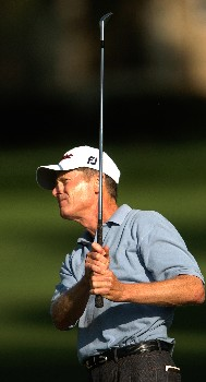 Mike Reid watches his second shot on the 15th hole during the second round of the Champions' Tour 2005 SBC Classic at  the Valencia Country Club in Valencia, California March 12, 2005.