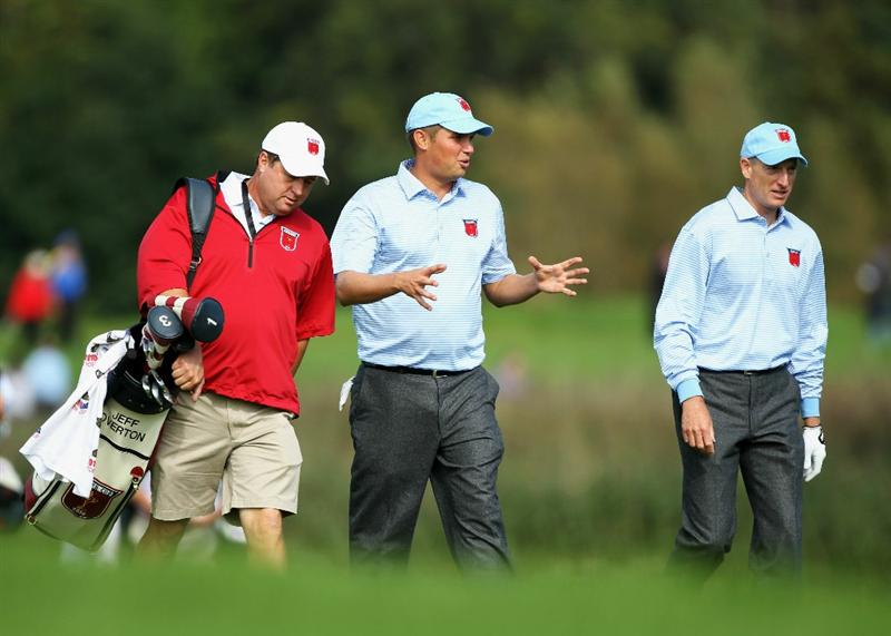 NEWPORT, WALES - SEPTEMBER 28:  Jeff Overton, (C) walks alongside his caddie Eric Larson and Jim Furyk of the USA during a practice round prior to the 2010 Ryder Cup at the Celtic Manor Resort on September 28, 2010 in Newport, Wales.  (Photo by Andy Lyons/Getty Images)