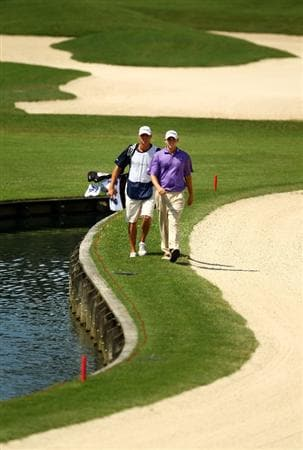 PONTE VEDRA BEACH, FL - MAY 08:  Bill Haas walks down the 11th with his caddy Micahel Maness during the third round of THE PLAYERS Championship held at THE PLAYERS Stadium course at TPC Sawgrass on May 8, 2010 in Ponte Vedra Beach, Florida.  (Photo by Richard Heathcote/Getty Images)