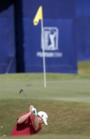 AVONDALE, LA - APRIL 25: Steve Marino hits from the greenside bunker on the 18th hole during the third round of the Zurich Classic at TPC Louisiana on April 25, 2009  in Avondale, Louisiana. (Photo by Dave Martin/Getty Images)