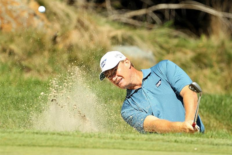 NORTON, MA - SEPTEMBER 05:  Ernie Els of South Africa hits a shot out of the bunker on the third hole during the third round of the Deutsche Bank Championship at TPC Boston on September 5, 2010 in Norton, Massachusetts.  (Photo by Mike Ehrmann/Getty Images)