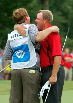GREENSBORO, NC - AUGUST 17:  Carl Pettersson (R) celebrates with his caddie after winning the 2008 Wyndham Championship at Sedgefield Country Club on August 17, 2008 in Greensboro, North Carolina.  (Photo by Kevin C. Cox/Getty Images)