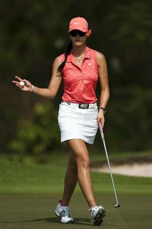 CHON BURI, THAILAND - FEBRUARY 20:  Michelle Wie of USA acknowledges to the crowd on the 12th green during day four of the LPGA Thailand at Siam Country Club on February 20, 2011 in Chon Buri, Thailand.  (Photo by Victor Fraile/Getty Images)