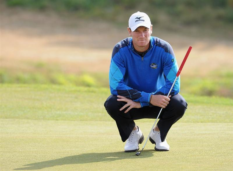 RAGUSA, ITALY - MARCH 18:  Chris Wood of England lines up his putt on the nineth hole during the second round of the Sicilian Open at the Donnafugata golf resort and spa on March 18, 2011 in Ragusa, Italy.  (Photo by Stuart Franklin/Getty Images)