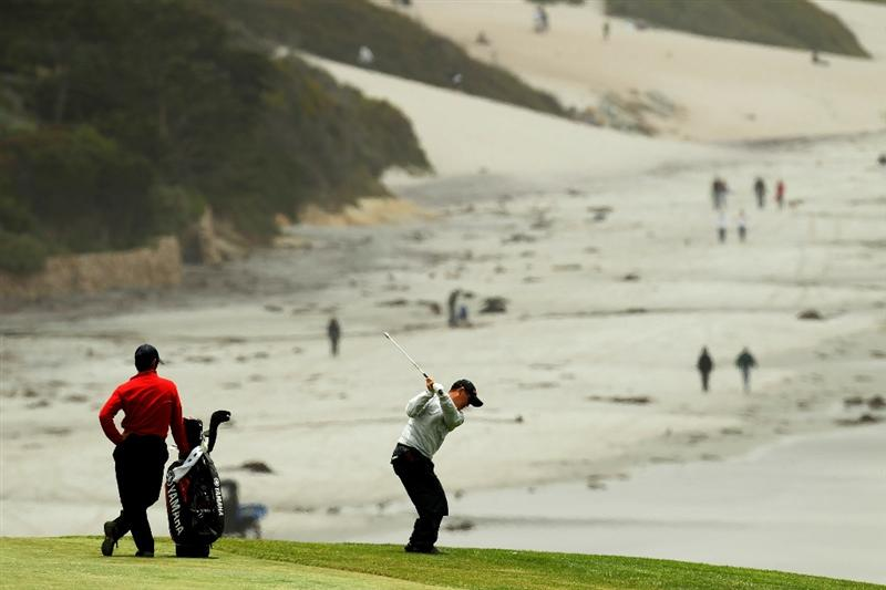 PEBBLE BEACH, CA - JUNE 15:  Toru Taniguchi of Japan hits a shot during a practice round prior to the start of the 110th U.S. Open at Pebble Beach Golf Links on June 15, 2010 in Pebble Beach, California.  (Photo by Ross Kinnaird/Getty Images)