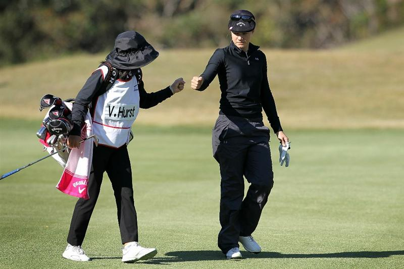 SHIMA, JAPAN - NOVEMBER 05:  Vicky Hurst of the United States walks with her caddie on the 12th hole during round one of the Mizuno Classic at Kintetsu Kashikojima Country Club on November 5, 2010 in Shima, Mie, Japan.  (Photo by Kiyoshi Ota/Getty Images)
