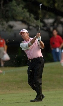 Dana Quigley follows the flight of his approach shot on the 17th fairway during the final round of the Champion's TOUR 2005 SBC Championship at Oak Hill Country Club in San Antonio, Texas October 23, 2005.Photo by Steve Grayson/WireImage.com