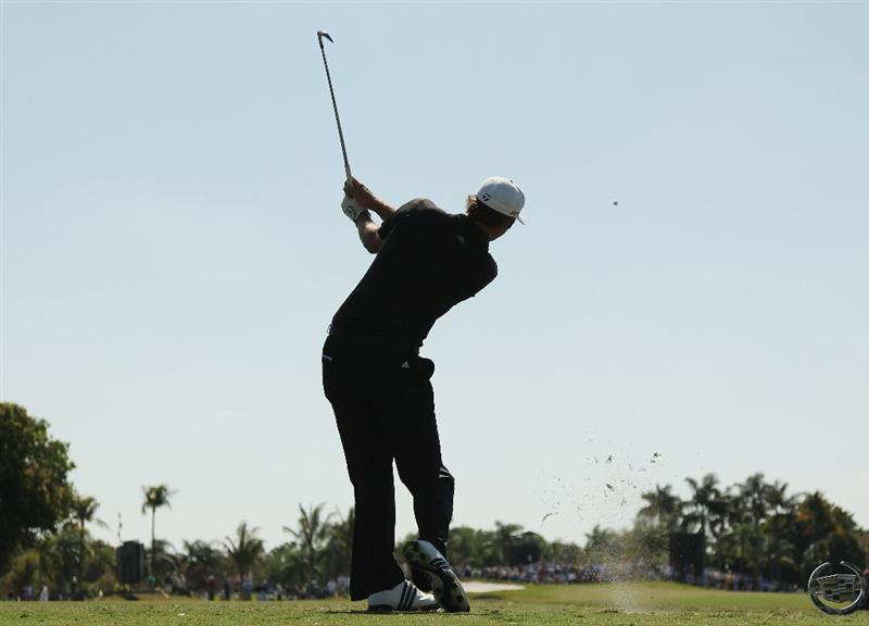 DORAL, FL - MARCH 13:  Dustin Johnson hits his tee shot on the fourth hole during the final round of the 2011 WGC- Cadillac Championship at the TPC Blue Monster at the Doral Golf Resort and Spa on March 13, 2011 in Doral, Florida.  (Photo by Mike Ehrmann/Getty Images)