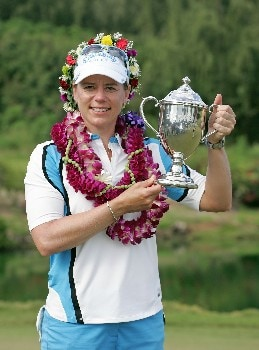 KAHUKU, HI - FEBRUARY 16:  Annika Sorenstam of Sweden poses with the winner's trophy after winning at the SBS Open on February 16, 2008  at the Turtle Bay Resort in Kahuku, Hawaii.  (Photo by Andy Lyons/Getty Images)