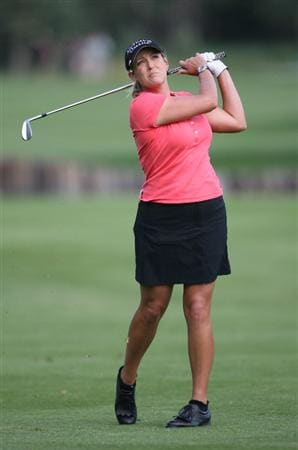 CALGARY, AB - SEPTEMBER 03: Cristie Kerr of the United States hits her third shot on the ninth hole during the first round of the Canadian Women's Open at Priddis Greens Golf & Country Club on September 3, 2009 in Calgary, Alberta, Canada. (Photo by Hunter Martin/Getty Images)