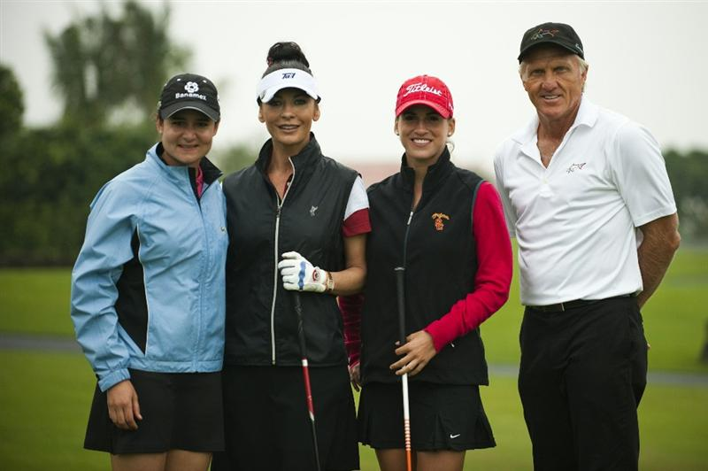 HAIKOU, CHINA - OCTOBER 27: (L-R) Former golf world number one Lorena Ochoa of Mexico, oscar-winning actress Catherine Zeta-Jones, Belen Mozo of Spain and golf legend Greg Norman pose ahead of the inaugural Mission Hills Star Trophy on October 27, 2010 in Haikou, China.  The Mission Hills Star Trophy is Asia's leading leisure liflestyle event and features Hollywood celebrities and international golf stars.  (Photo by Victor Fraile/Getty Images)