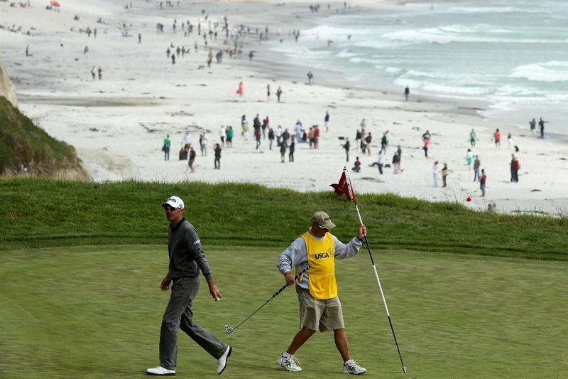 PEBBLE BEACH, CA - JUNE 20:  Gregory Havret of France waits with his caddie Garry Melia on the ninth green during the final round of the 110th U.S. Open at Pebble Beach Golf Links on June 20, 2010 in Pebble Beach, California.  (Photo by Donald Miralle/Getty Images)