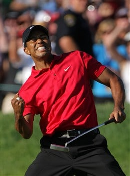 SAN DIEGO - JUNE 15:  Tiger Woods reacts to his birdie putt on the 18th green to force a playoff with Rocco Mediate during the final round of the 108th U.S. Open at the Torrey Pines Golf Course (South Course) on June 15, 2008 in San Diego, California.  (Photo by Doug Pensinger/Getty Images)