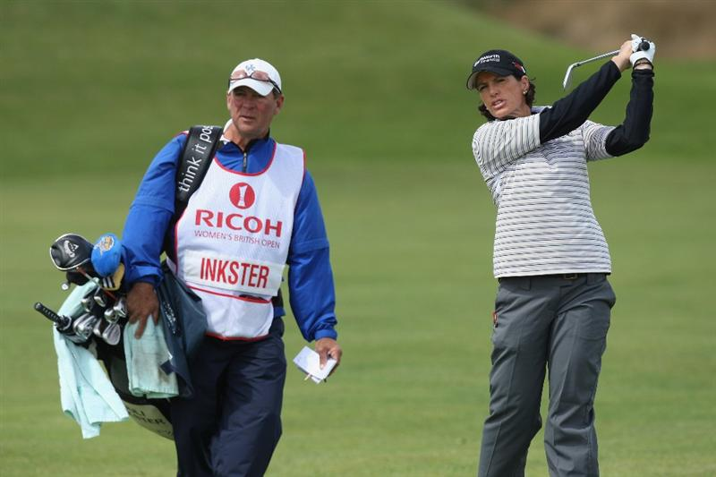 LYTHAM ST ANNES, UNITED KINGDOM - JULY 30:  Juli Inkster of USA hits a shot as Caddie Worth Blackwelder  looks on during the first round of the 2009 Ricoh Women's British Open Championship held at Royal Lytham St Annes Golf Club, on July 30, 2009 in  Lytham St Annes, England. (Photo by David Cannon/Getty Images)