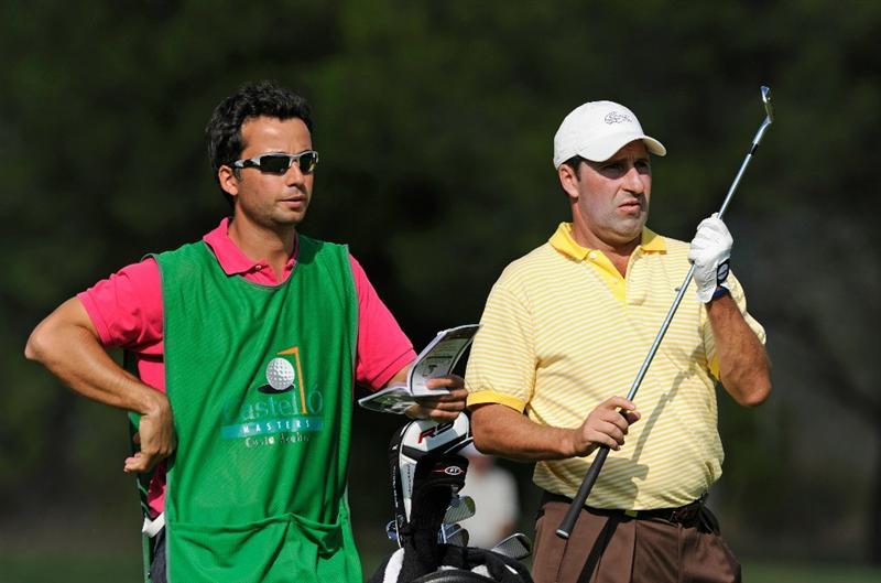 CASTELLON DE LA PLANA, SPAIN - OCTOBER 22:  Jose Maria Olazabal of Spain and caddie Alex Larrazabal discuss his approach shot on the nineth hole during the second round of the Castello Masters Costa Azahar at the Club de Campo del Mediterraneo on October 22, 2010 in Castellon de la Plana, Spain.  (Photo by Stuart Franklin/Getty Images)