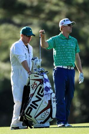 AUGUSTA, GA - APRIL 09: Hunter Mahan (R) pulls a club from his bag on the 14th hole alongside caddie John Wood during the second round of the 2010 Masters Tournament at Augusta National Golf Club on April 9, 2010 in Augusta, Georgia.  (Photo by David Cannon/Getty Images)
