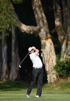 HONG KONG - NOVEMBER 17:  Marcus Fraser of Australia plays his approach shot on the 17th hole during the third round of the UBS Hong Kong Open at the Hong Kong Golf Club on November 17, 2007 in Fanling, Hong Kong.  (Photo by Stuart Franklin/Getty Images)