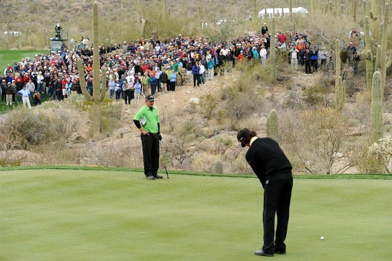 MARANA, AZ - FEBRUARY 26:  Bubba Watson putts on the 18th hole as J.B. Holmes watches during the quarterfinal round of the Accenture Match Play Championship at the Ritz-Carlton Golf Club on February 26, 2011 in Marana, Arizona.  (Photo by Stuart Franklin/Getty Images)