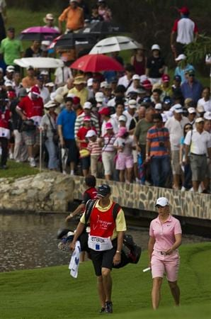 CHON BURI, THAILAND - FEBRUARY 20:  Spectators follow Suzann Pettersen to the 8th hole during round three of the Honda PTT LPGA Thailand at Siam Country Club on February 20, 2010 in Chon Buri, Thailand.  (Photo by Victor Fraile/Getty Images)