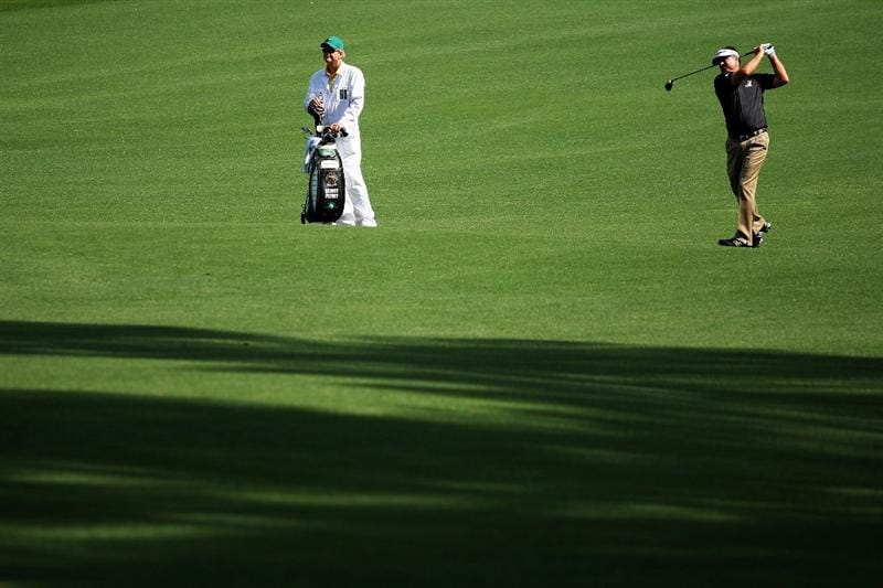 AUGUSTA, GA - APRIL 11:  Kenny Perry watches his second shot on the eighth hole alongside his caddie Fred Sanders during the third round of the 2009 Masters Tournament at Augusta National Golf Club on April 11, 2009 in Augusta, Georgia.  (Photo by Andrew Redington/Getty Images)