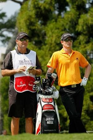 ATLANTA - SEPTEMBER 23:  Justin Rose of England (R) talks with his caddie Mark Fulcher (L) on the second tee during the first round of THE TOUR Championship presented by Coca-Cola at East Lake Golf Club on September 23, 2010 in Atlanta, Georgia.  (Photo by Kevin C. Cox/Getty Images)